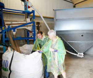 Jack Rogers with team member in cold pressing part of newgrange gold farm