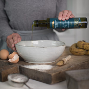 Lady cooking using Newgrange Gold Wild Flax Oil