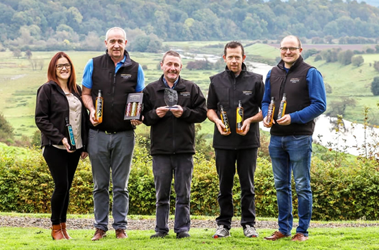 Newgrange Gold Team holding bottles of Newgrange Gold Rapeseed Oil